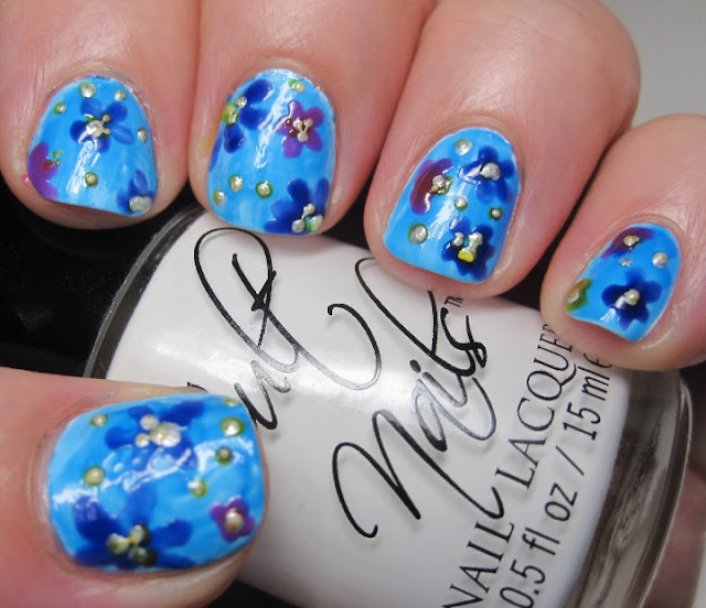 Cult Nails Tempest with a wash of Pink Cookie Neon Blue, and neon flowers