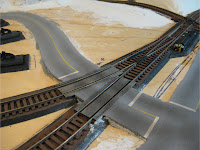 Pastel weathering effects on road and grade crossings