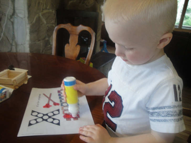 We used our Wikki Stix to make an X on our Playdough Mat . title=