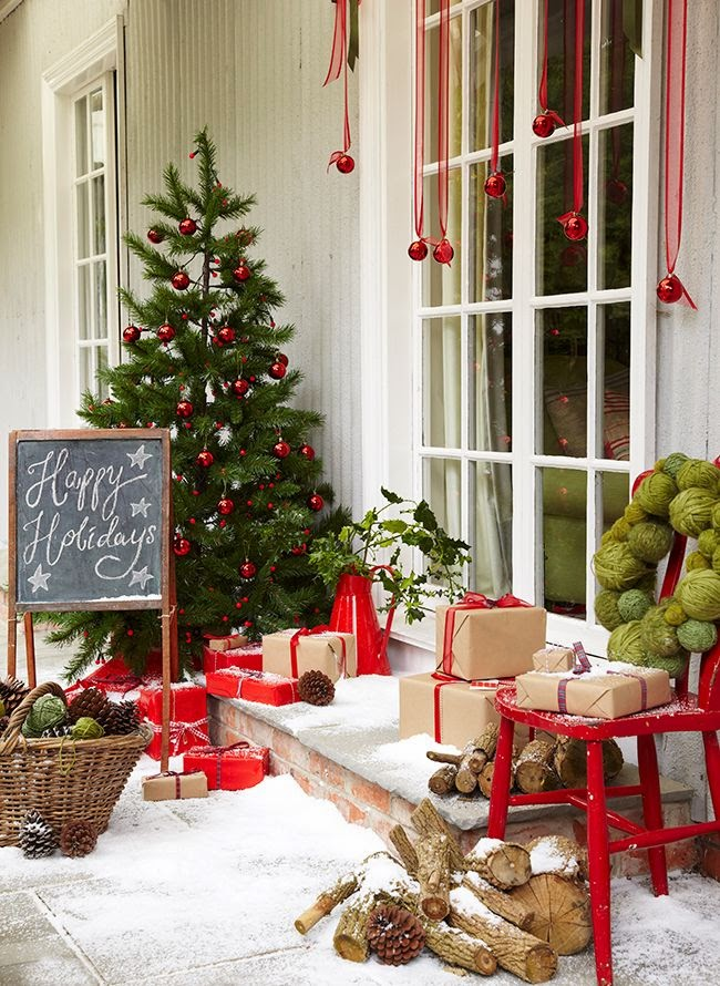 first up theres this beautiful front porch from the relaxed home i love the idea of wrapping empty boxes up with paper and creating fake presents