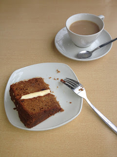Cup of tea and a slice of apple and cinnamon cake