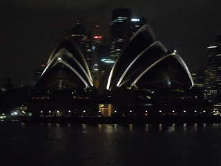 sydney opera house at night from water