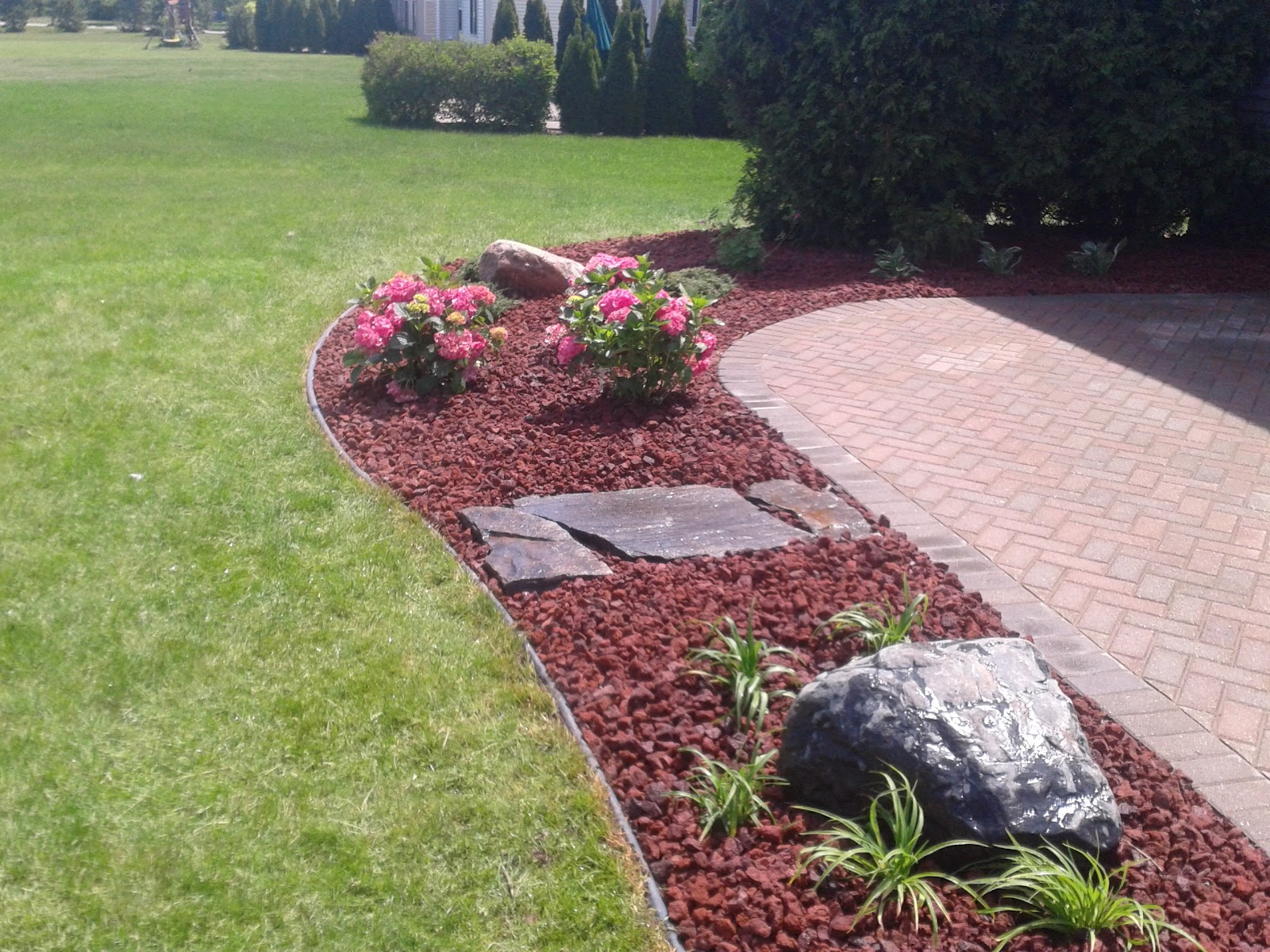 Brick paver patio design installation and maintenance for Lava rock pavers