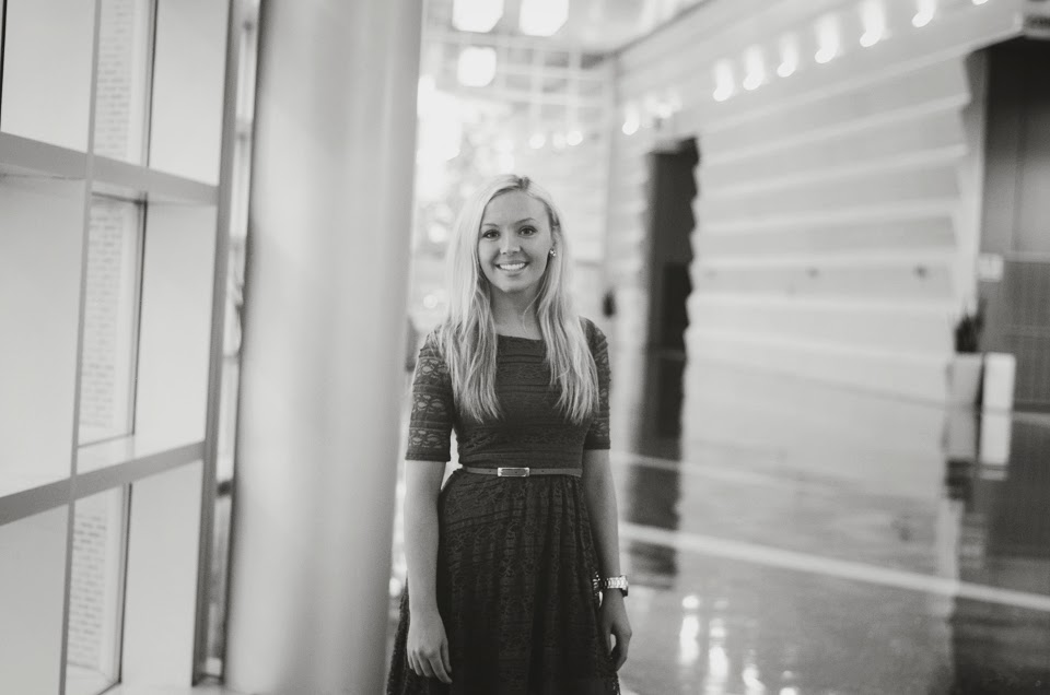 Black and white image of Katlyn, posing for senior pictures, at the Grand Wayne Center, in downtown Fort Wayne.