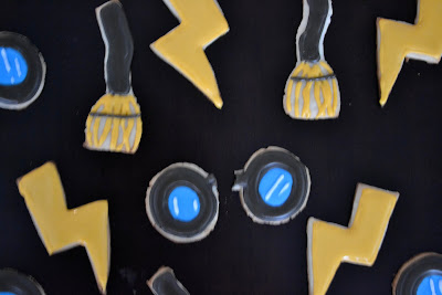 Harry Potter themed sugar cookies on a black table.