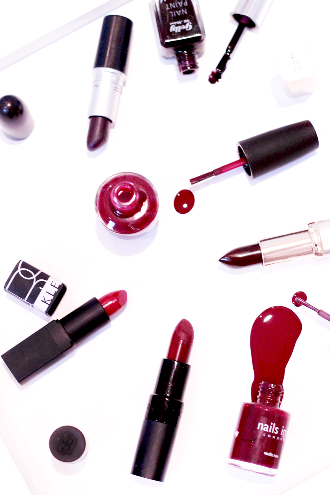 Image of lipsticks & nail combinations: Barry M Gelly Black Currant; OPI The Cable Car Pool; Nails Inc Saville Row
