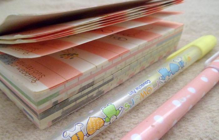 caderno, canetas, projeto dias felizes