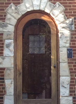 sears front door rounded wood door with curved iron hinge at top