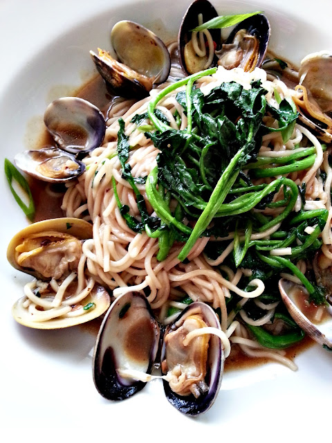 sizzled clams with noodles and watercress