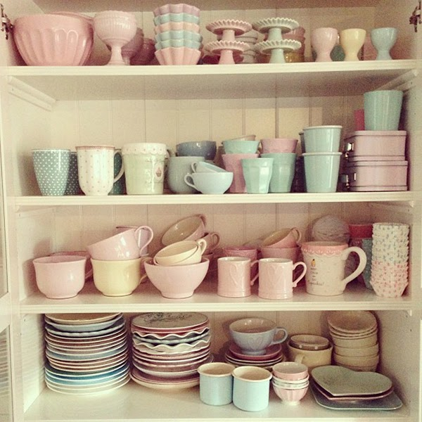 A cupboard full of pastel crockery from Manual PassionForBaking blog - Retro Pastel Kitchen Colors That'll Make You Squeal!