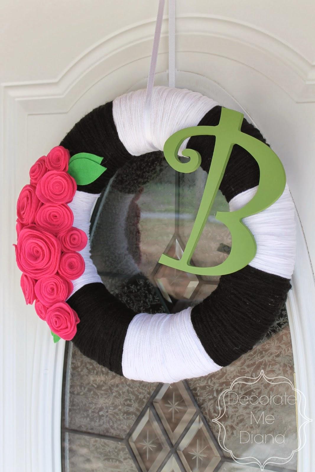 http://www.decoratemediana.com/2014/03/diy-yarn-rosette-wreath.html