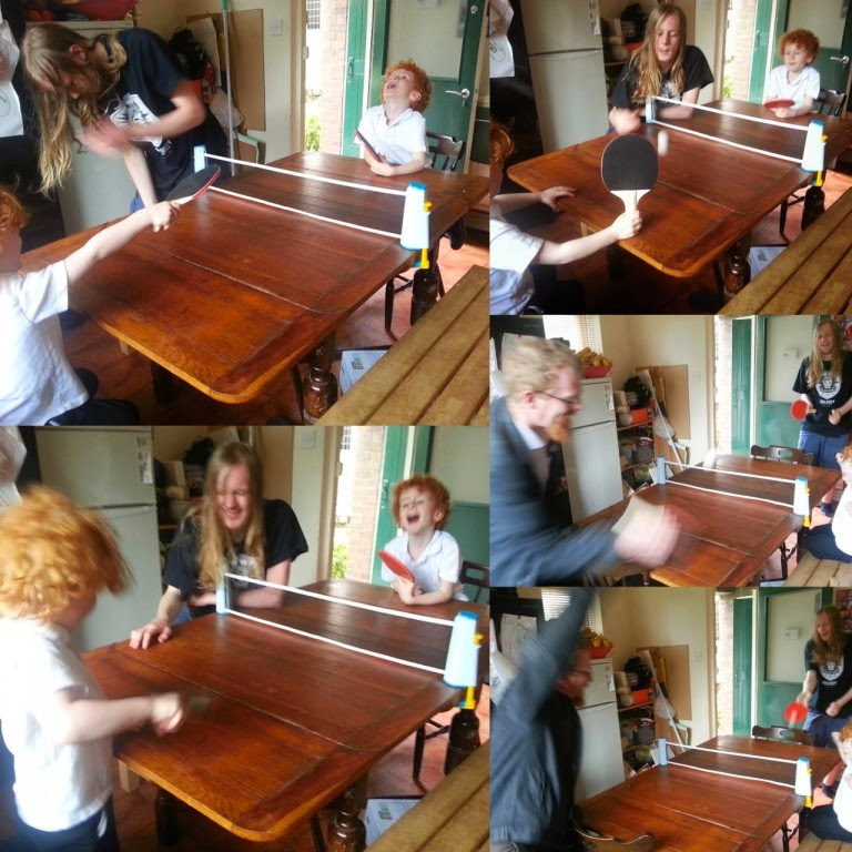 People playing table tennis in the kitchen
