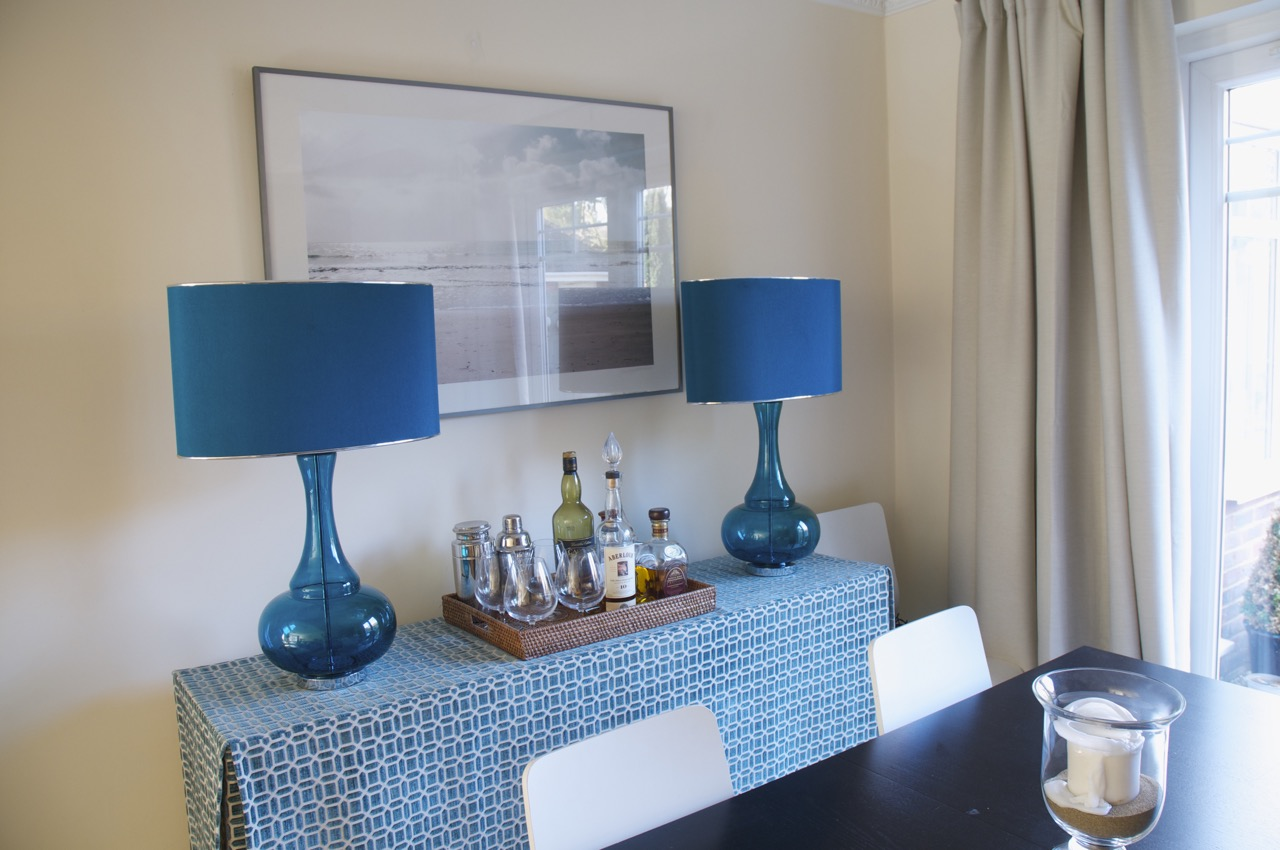 The Stylish Interior - Console, lamps and art in the dining-room