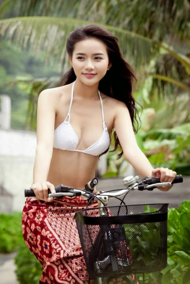 Hot beautiful asian girls on bicycle