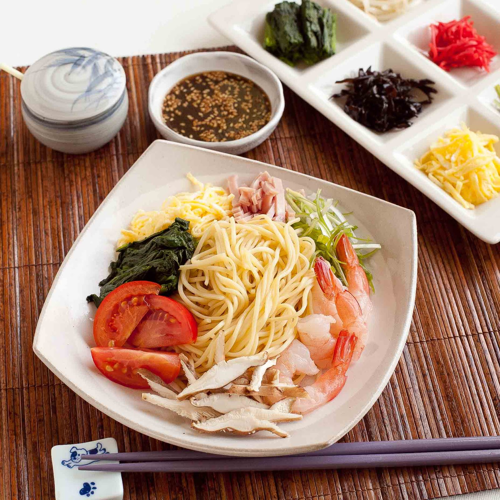 Top the cooked and chilled ramen noodles with all sorts of toppings ...