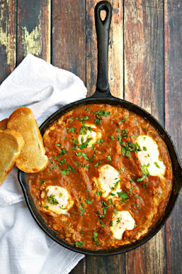 http://www.thewickednoodle.com/baked-eggs-recipe-in-tomato-chipotle-sauce/