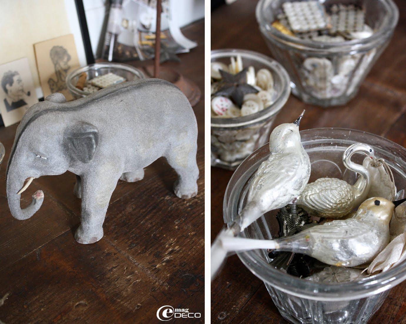 Un éléphant en plâtre et feutrine provenant d'une ancienne crèche et des oiseaux au mercure