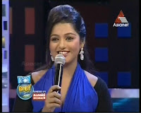: Asianet Comedy stars Season2 Anchor Meera in transparent saree pics