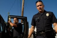 End of Watch Movie - The film stars Jake Gyllenhaal and Michael Peña as a couple of uniformed officers who overstep their bounds when they decide to investigate a drug cartel and end up becoming targets.