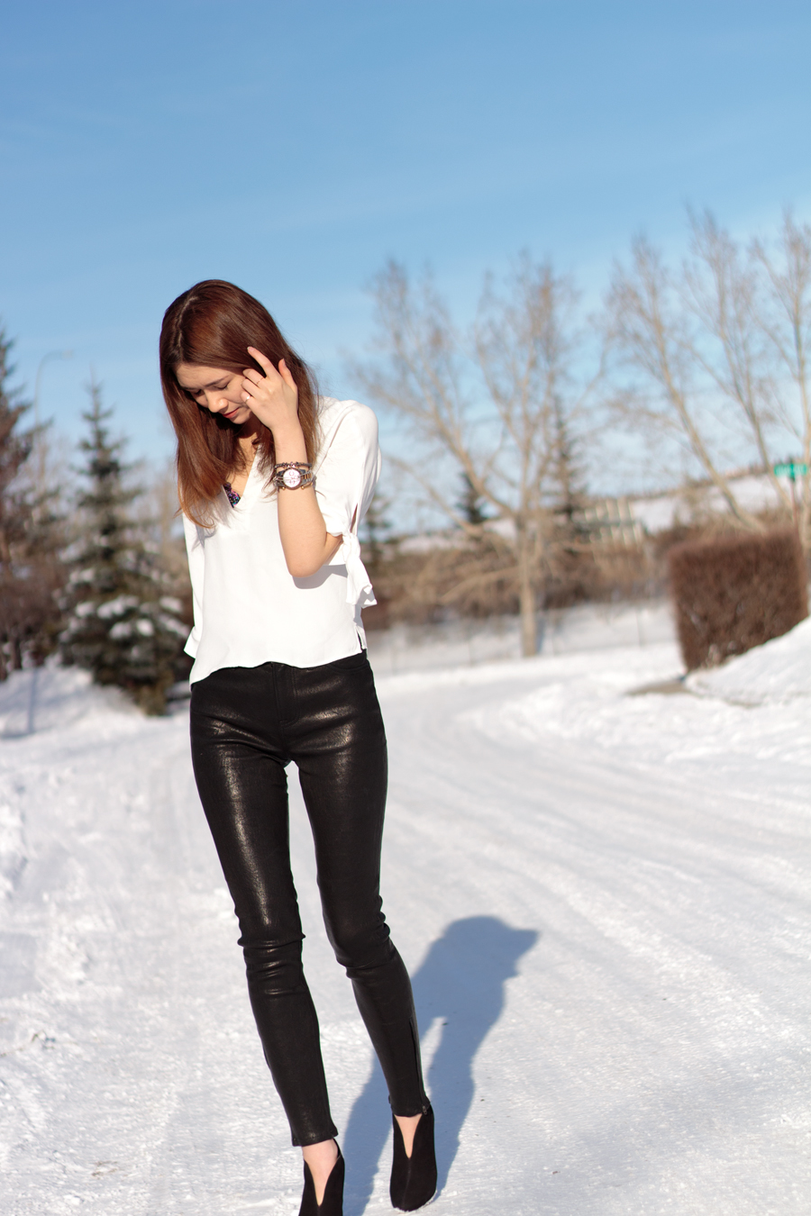 tips for buying leather pants, bow sleeved blouse, leather pants, nine west nero, michael kors watch, jbrand
