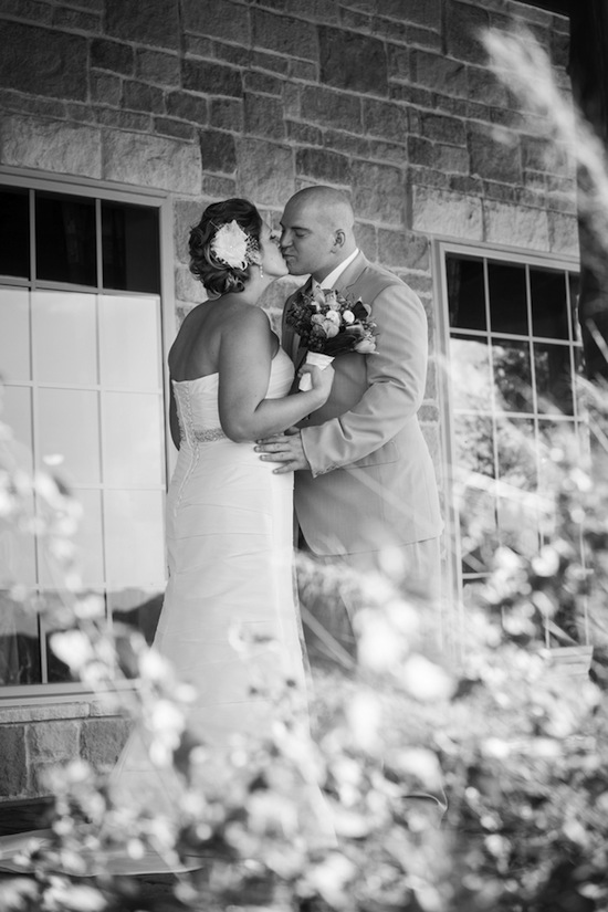 black and white of the couple kissing
