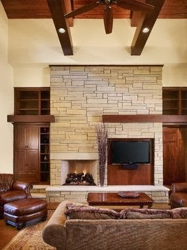 stone fireplace, asymmetrical tv fireplace