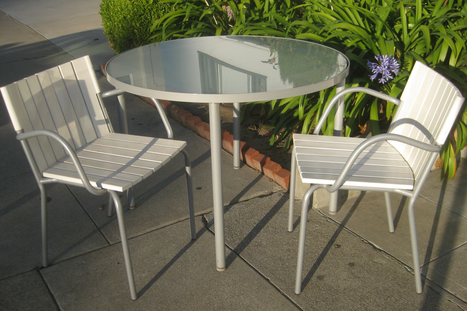 Uhuru furniture collectibles sold patio table and two for Outside table and chairs