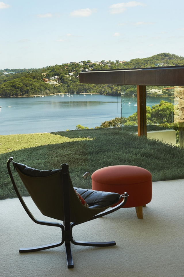 A chair on the terrace looking on the bay