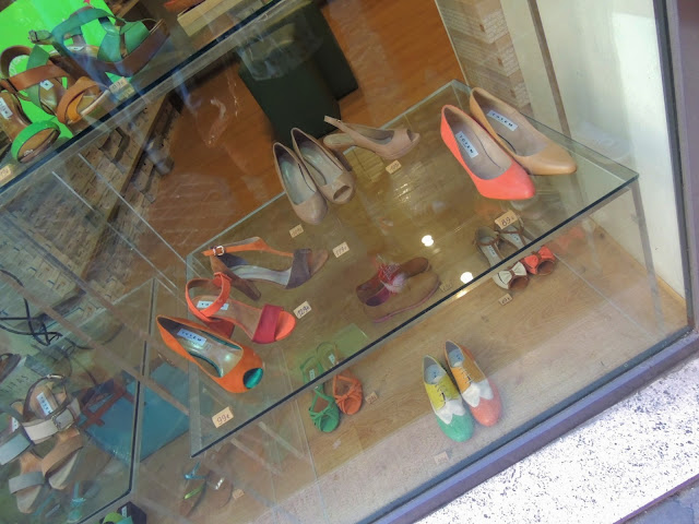 Fluorescent shoes in shop window, Rome