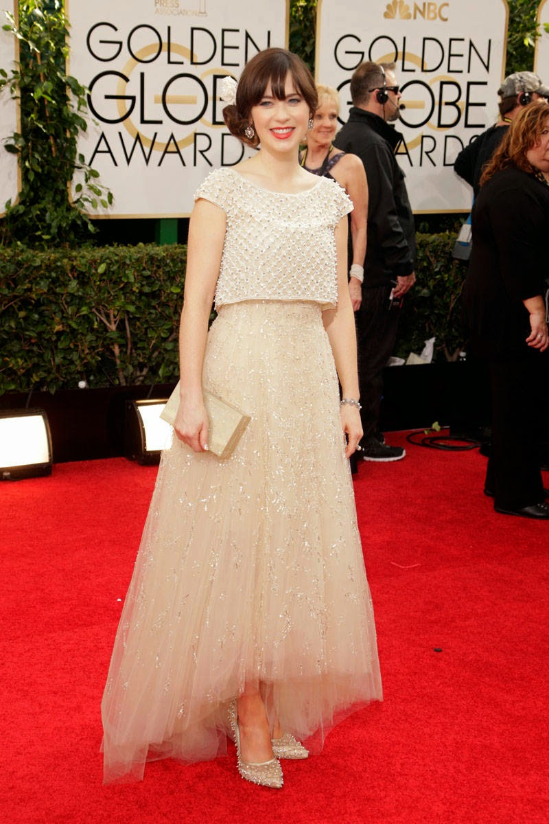 Zooey Deschanel in Oscar de la Renta. Check out this modest ivory tulle maxi skirt