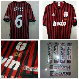 gambar desain klasik jersey retro Jersey retro AC Milan home terbaru tahun 2009 kualitas grade AAA di enkosa sport