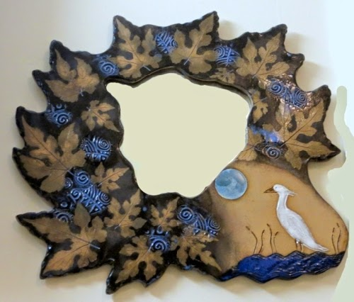 http://www.carolinacreationsnewbern.com/NewFiles/A-Libby-Freeform-mirror.php