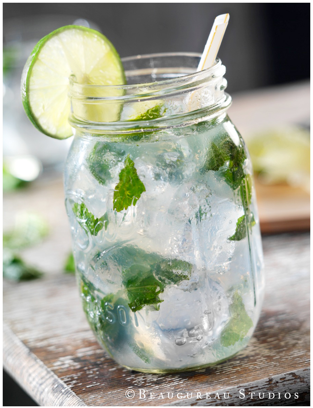 Mint Mojito - garnished with a lime and torn mint leaves