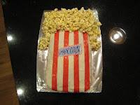 cake decorated like a movie theater bag of popcorn