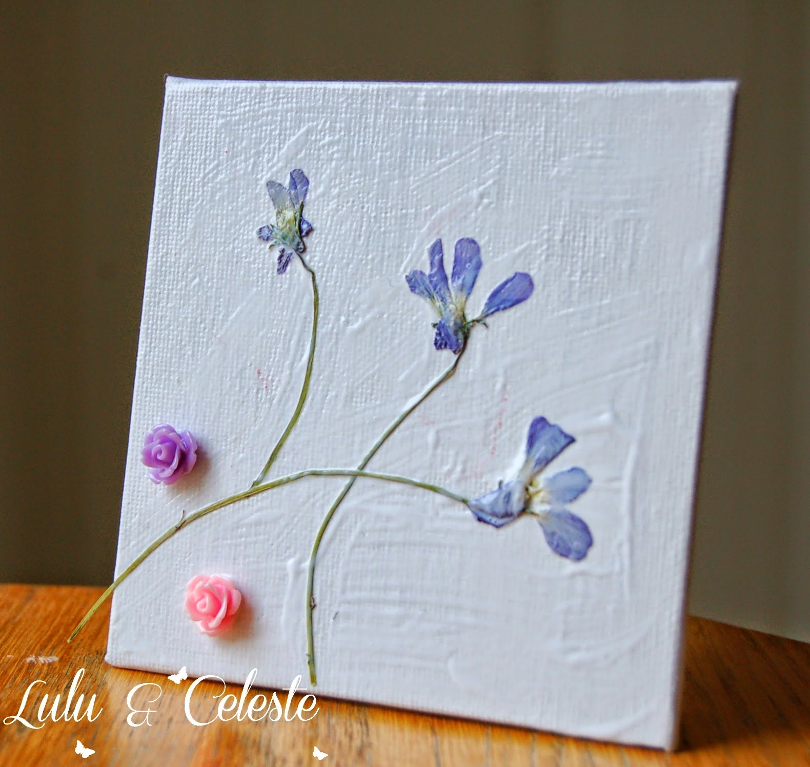 http://luluandceleste.blogspot.ca/2014/07/pressed-flower-artwork-for-children.html