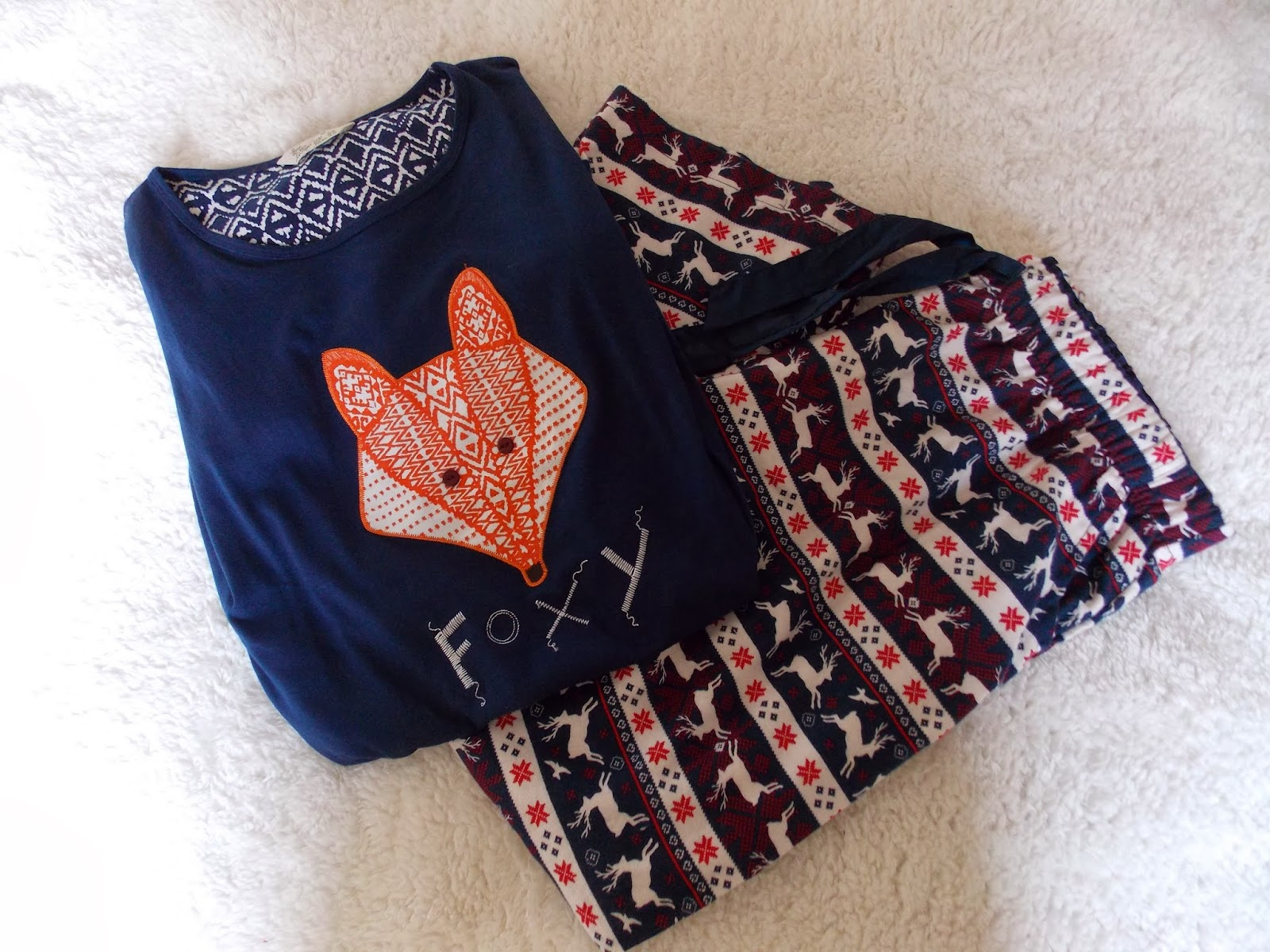 A primark nightie with fox print and pyjama bottoms with leaping reindeer