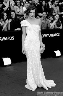 Milla Jovovich over red carpet at 2012 Academy Awards - Oscar arrival