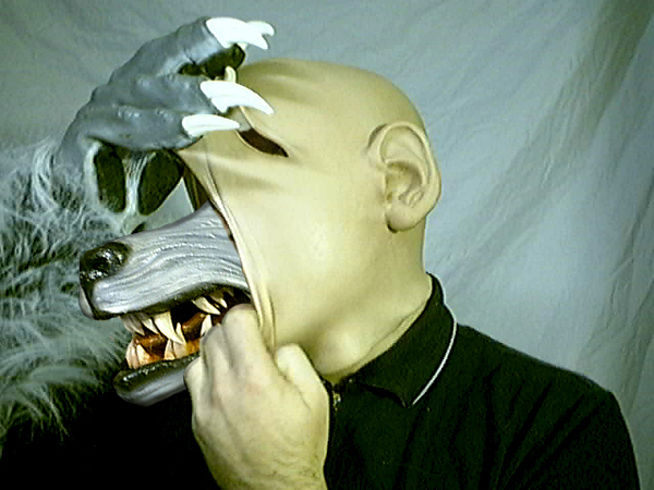 Wolf_Ripping_From_human_skin_by_masked_pup.jpg