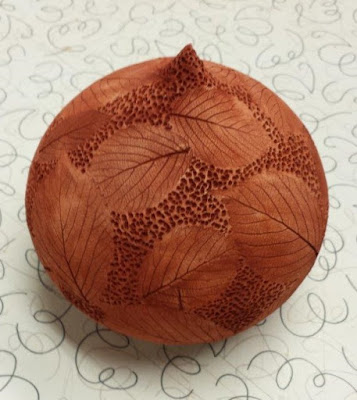 Beautiful leaf imprint ceramic pottery hand thrown vessel - in progress.