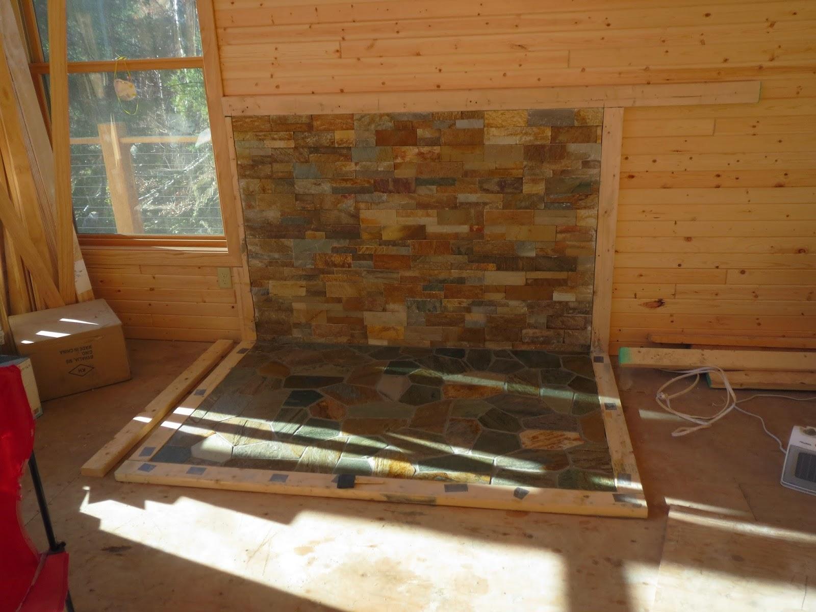 wood-stove, backing, floor, rock, venneer, huisman, ely, lake, cabin, custom,