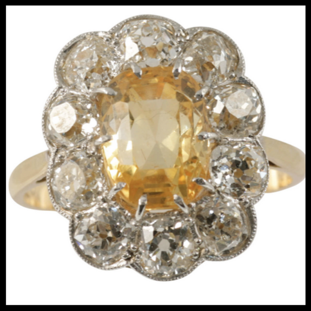Sapphire surrounded by Old Mine Cut Diamond Halo with milgrain and yellow gold shank