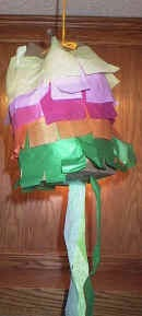 http://www.dltk-kids.com/world/mexico/simple_paper_bag_pinata.htm