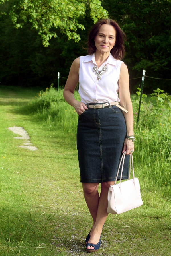 Amazing  Brunette Pretty Mature Woman Wearing Black Top  Layered White Skirt