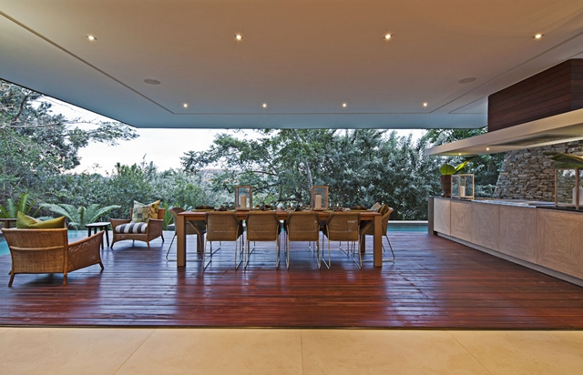 Big terrace with table and chairs in the Contemporary South African SGNW House by Metropole Architects