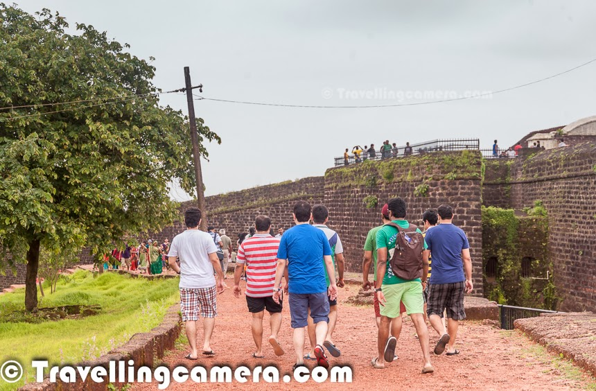 Aguada Fort is very popular destination for tourists in goa. It's not only about tourists who love thials place but localities and Bollywood keeps showing their love the place. Many of the bollywood movies are shot at this place and 'Rang de Basanti' is known the most among them. Aguada Fort looks awesome during monsoons and exposes to an amazing view of the sea from a high place. This Photo Journey shares some of the moments spent around Aguada Fort through Photographs. All of the Aguada Fort pictures in this Photo Journey are clicked during monsoon season. Aguada fort is very approachable from differentplaces in Goa like Panjim, Candolim, Calangule, Baga etc. The Fort Aguada is a very well preserved portuguese fort which is there in Goa for last few centuaries. This is actually located near Sinquerim Beach, overlooking the Arabian Sea around India. There is a working lighthouse inside this fort which you must have noticed in the first photograph as well in the photograph just above.  Aguada Fort is located around 20 kilometers from Panajim, the Old part of Goa.Almost every tourist who comes to Goa, visits Aguada Fort. Aguada Fort timings are 10:00 AM - 5:30 PM. It's open on all days of the week. I thought of sharing timings here because, before coming to Aguada Fort we checked for two things - Timings & it's location on Map. Aguada fort map is much needed becausin Goa, you get different information about this fort from different sources. We realized that the name Aguada is used by many properties and many times people may guide you to some property.The Aguada fort was constructed in 16th centuary to guard this land against the Dutch and the Marathas. Aguada was a reference point for the vessels coming from Europe in old days. Aguada is an old Portuguese fort which is on south of Candolim beach and stands at the shore of the Mandovi River.Above photogrph shows amazing views of Arabic Sea... As shown in bollywood movie 'Rang de Basanti', this place expose tourists to some of the unique views & experiences of Goa. We went there in morning and found it best time to visit. Usually Aguada Fort is very crowded with tourists, so it's recommended to reach there early, which essentially means 10 am and explore the place. After our visit to Aguada Fort, we drove to the beach which was near Goa Jail. Many of the folks were doing fishing there and we saw hundreds of crabs on the beach. This was an awesome experience and we shall dedicate a separate Photo Journey to those crabs :)Many times, Goans confuse the fort with Aguada fort Taj which comes on the way to the fort and it's one of the most popular properties to stay in Goa. Apart from that many folks visit Vivanta by Taj and beaches around it. It has also become one of the main tourist destination. There are few fort like structures around Vivanta where tourists like to visit to witness high tides of the seaName of Aguada Fort is taken from freshwater spring which used to suppy water to the ships coming there. 'Agua' in actually a portuguese means water, and hence the fort was named 'Aguada' to denote a place where water is accumulated. There was time when fort was protected by more than 200 cannons and a deep dry moat, which one still has to cross to get inside. More details about history of this fort can be checked at - http://www.goatourism.gov.in/destinations/forts/150-aguada-fortFort has multiple levels and one needs to climb stairs to explore fort, so it's not recommended for folks having trouble in climbing high places and in general one needs to walk a lot to explore the fort. It seems that the land around the fort is now owned by The Indian Hotels Company. On the ramparts behind the fort is the Fort Aguada Beach Resort. This property is owned by Tatas and is part of an 85+ acres complex overlooking the Arabian Sea. It is situated on Sinquerim Beach and looks beautiful from road. Fort Aguada Beach Resort looks awesome with beautiful villas and cottages, with unmatchable views of Arabian sea.We didn't spend much time around Aguada Fort, as the list to do was long and there were many more exciting things in our mind. But it was wroth visiting Aguada Fort for short splan of time... On the back journey we noticed a beautoful beach with lot of ships parked there and planned to visit the same. It was Coco beach and following link shares the exciting experience with fishermen on the Coco Beach.