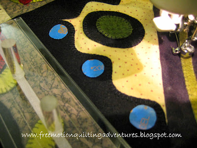 marking circles with tape for free motion quilting