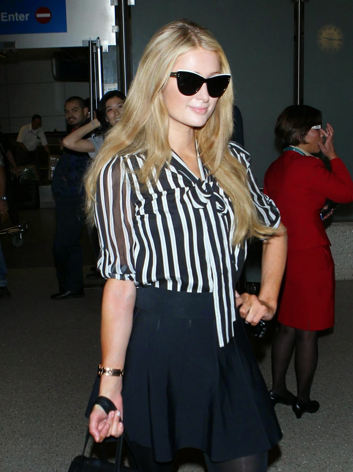 Socialite, Television Personality, Model, Actress, Singer @ Paris Hilton arrives back at LAX