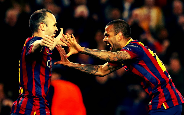 Dani Alves and Iniesta Celebrating against Manchester City