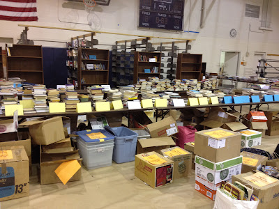 Photo of piles of books for NA FIeld Day Used Book Sale 2012