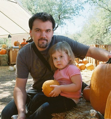 picking the pumpkin with daddy